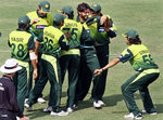 Shahid Afridi celebrates the wicket of AB de Villiers with his teammates
