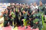 The victorious Pakistan team strikes a happy pose