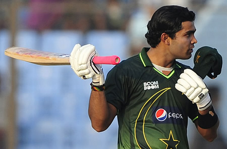 Umar Akmal celebrates on reaching his half-century