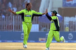 Shoaib Akhtar celebrates with Salman Butt after taking a wicket